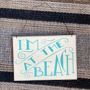 I'm at the beach hanging sign